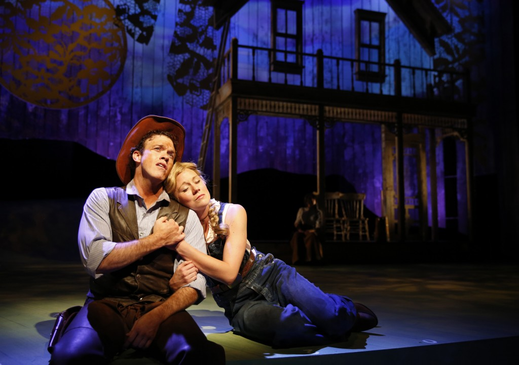 PT_OK_1.jpg - Colte Julian plays Curly and Allison Sill is Laurey in Paramount Theatre's 2015-16 Broadway Musical Series season opener, Oklahoma! Paramount Artistic Director Jim Corti directs the epic, debut collaboration between Rodgers and Hammerstein about turn of the century American pioneers. Performances run through October 18, 2015 at the Paramount Theatre, 23 E. Galena Blvd. in downtown Aurora. For tickets and information, visit ParamountAurora.com or call (630) 896-6666. Photo credit: Liz Lauren